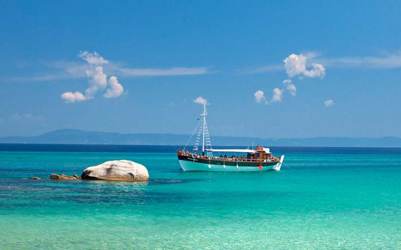 Chalkidiki clean water coast & tourist boat
