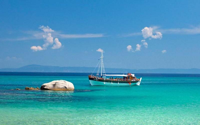 Chalkidiki clean water coast & tourist boat